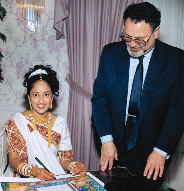 Bet Halevi-Rabbi Mordecai Genn, Ph.D., the bride signs the Ketubah