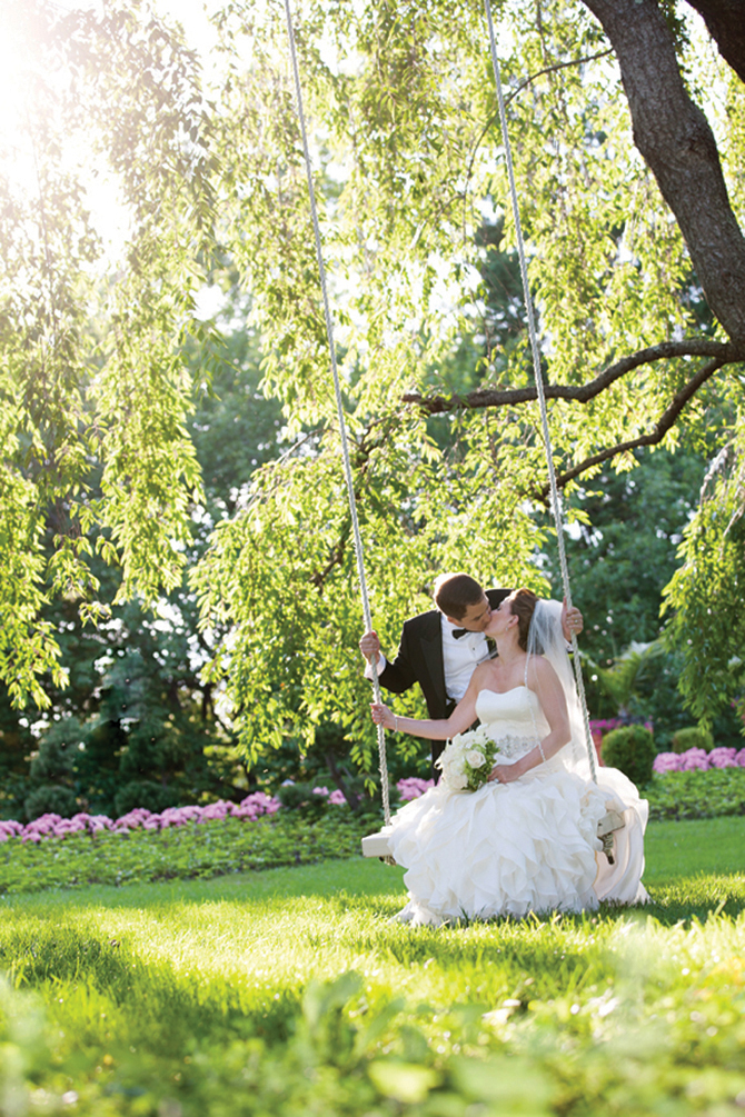 Milton Gil Photographers, Bride on Garden Swing