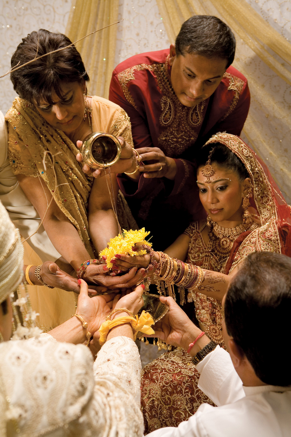 An Indian Wedding Ritual With The Bride
