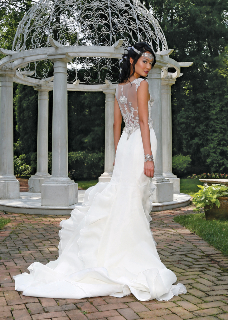 Gown: Eve of Milady (4322, $4,200). Flora Design