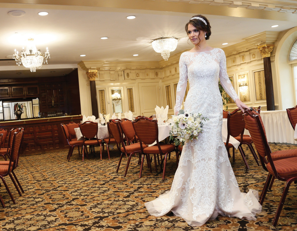 Gown: Oleg Cassini at David's Bridal(CWG670, $1,450)