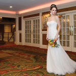 Gown: Oleg Cassini at David's Bridal (CWG668, $1,150)