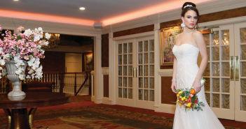 Gown: Oleg Cassini at David's Bridal (CWG668, $1,150)