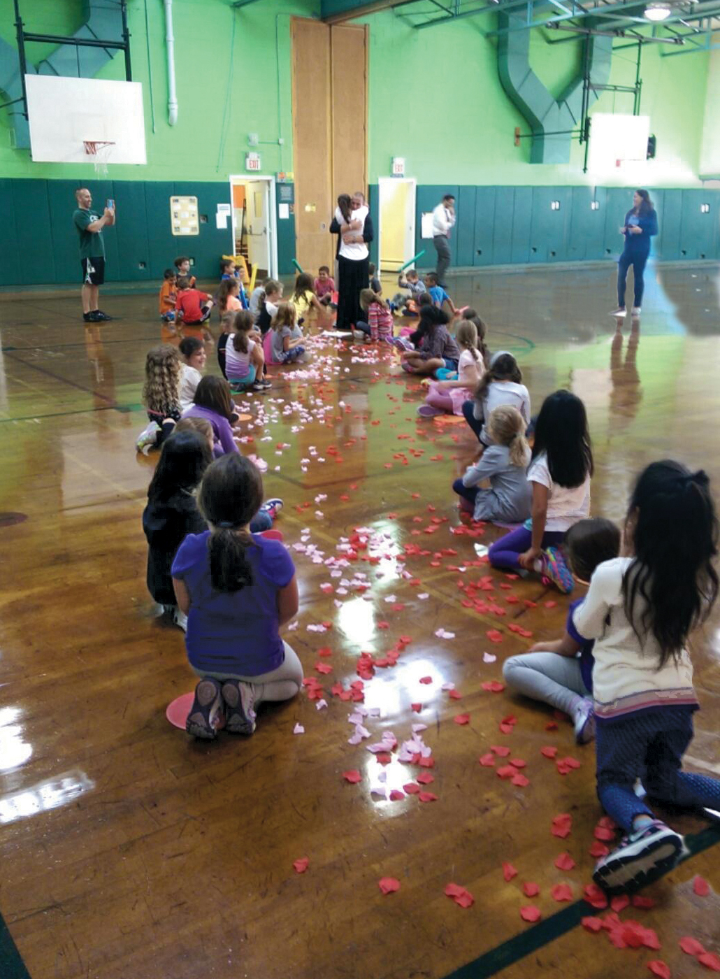 The proposal ... and the rose petal-lined gym floor with her students
