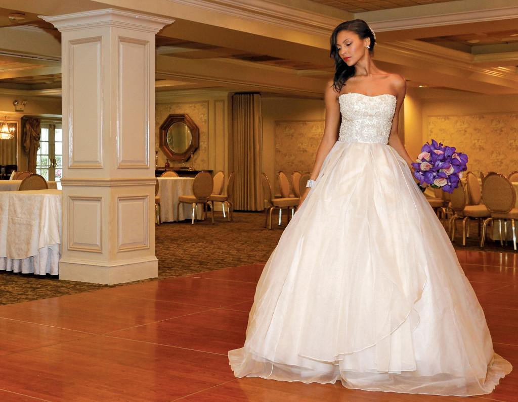 Gown: Lucia Rodriguez (LW1945, $5,500). Bouquet: Ariston Flowers