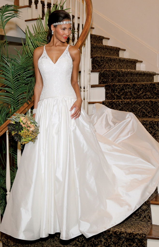 Gown: The Steven Birnbaum Collection (Flora, $3,500). Bouquet: KC Events