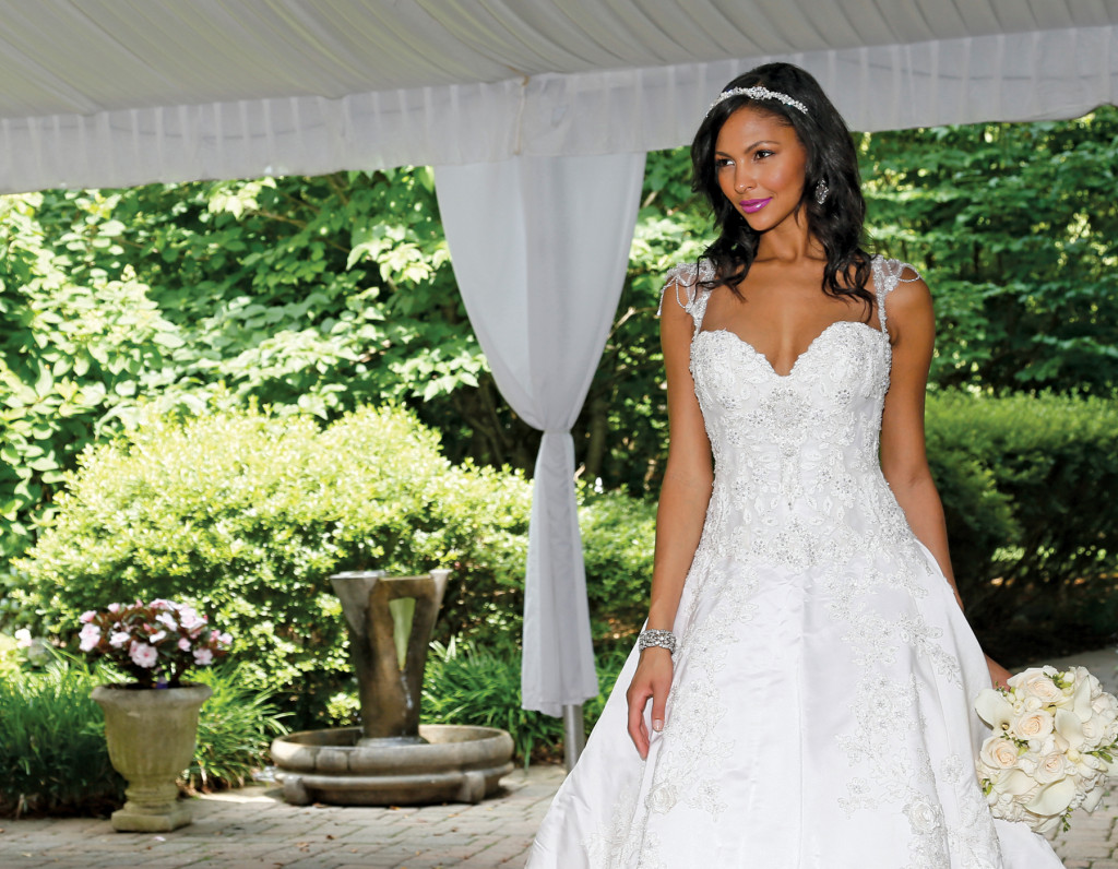 Gown: Eve of Milady (335, $6,600). Bouquet: Ariston Flowers