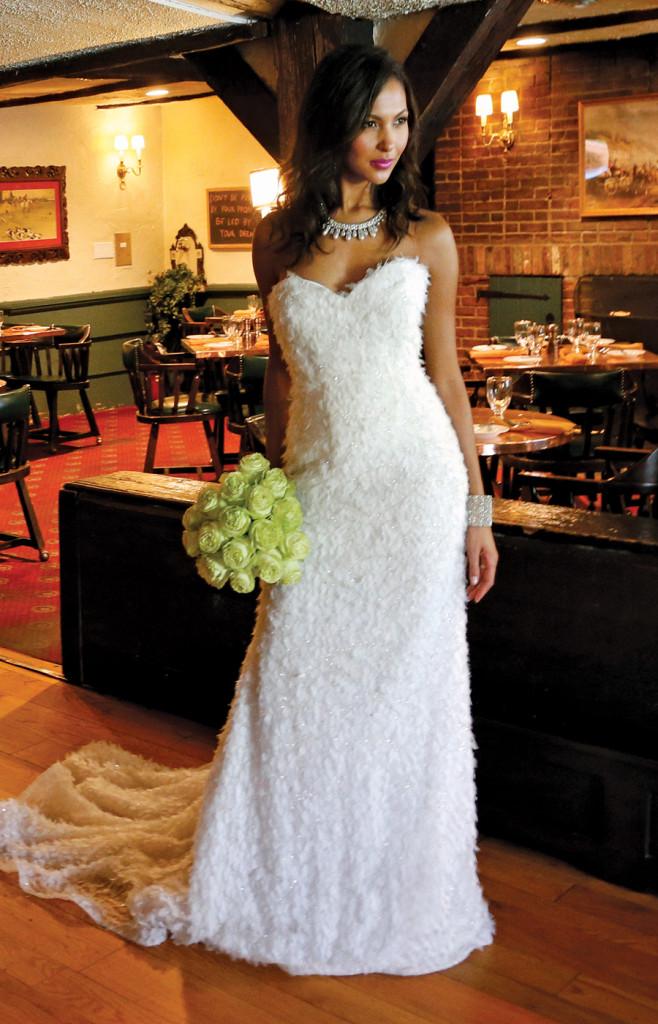 Gown: Lucia Rodriguez (LW1947, $7,200). Bouquet: Ariston Flowers