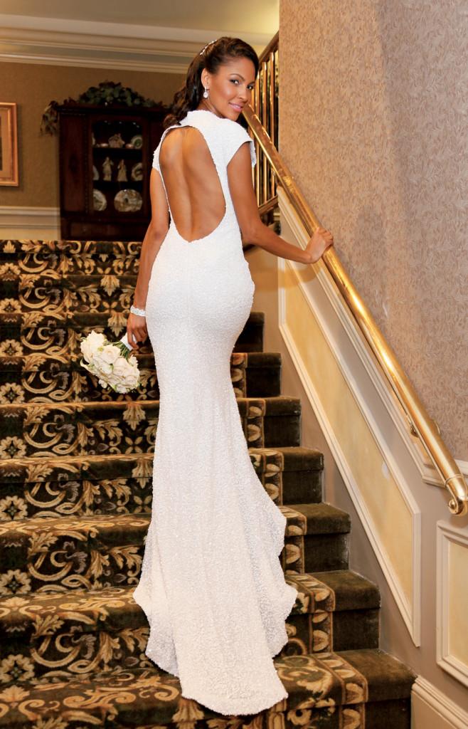 Gown: Belluccio (Melinda Kemp, $2,200) at Designer Loft. Bouquet: Ariston Flowers