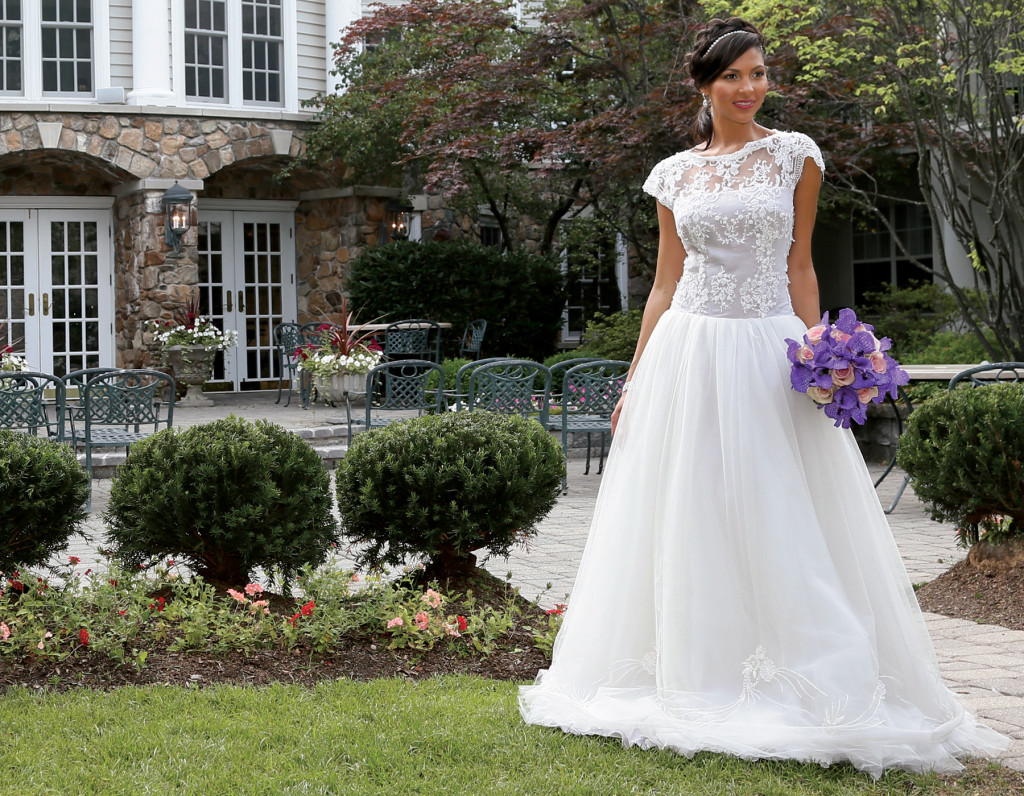 Gown: Lucia Rodriguez (LW1939, $4,500). Bouquets: Ariston Flowers