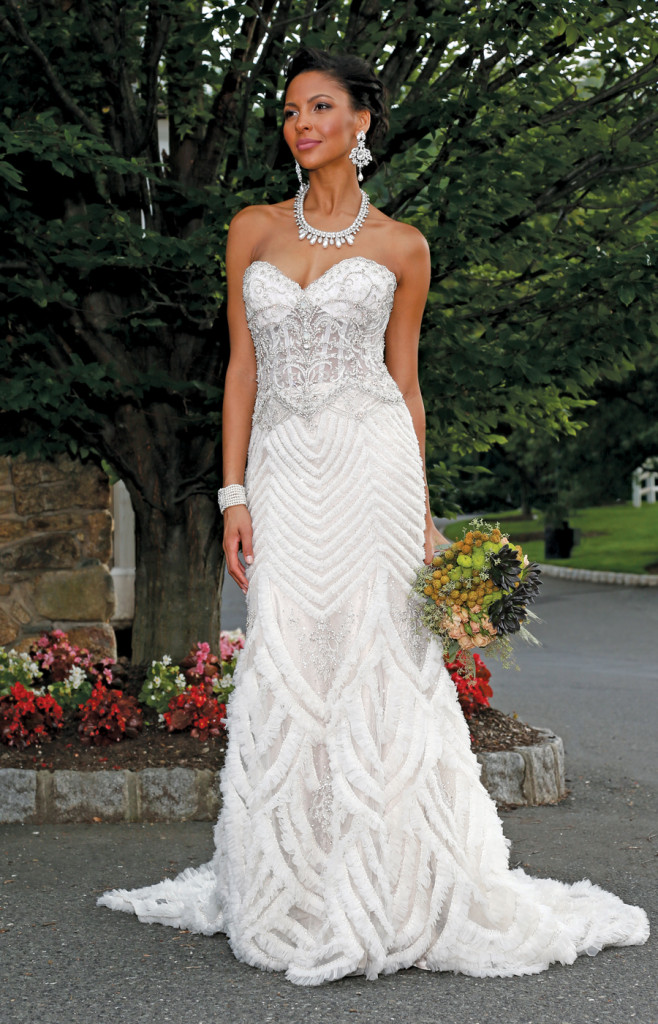 Gown: Eve of Milady (337, $5,800). Bouquet: KC Events