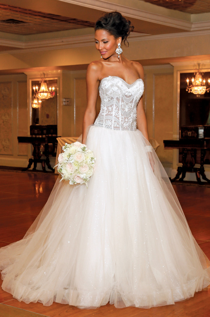 Gown: Eve of Milady (1531, $3,600). Bouquet: KC Events