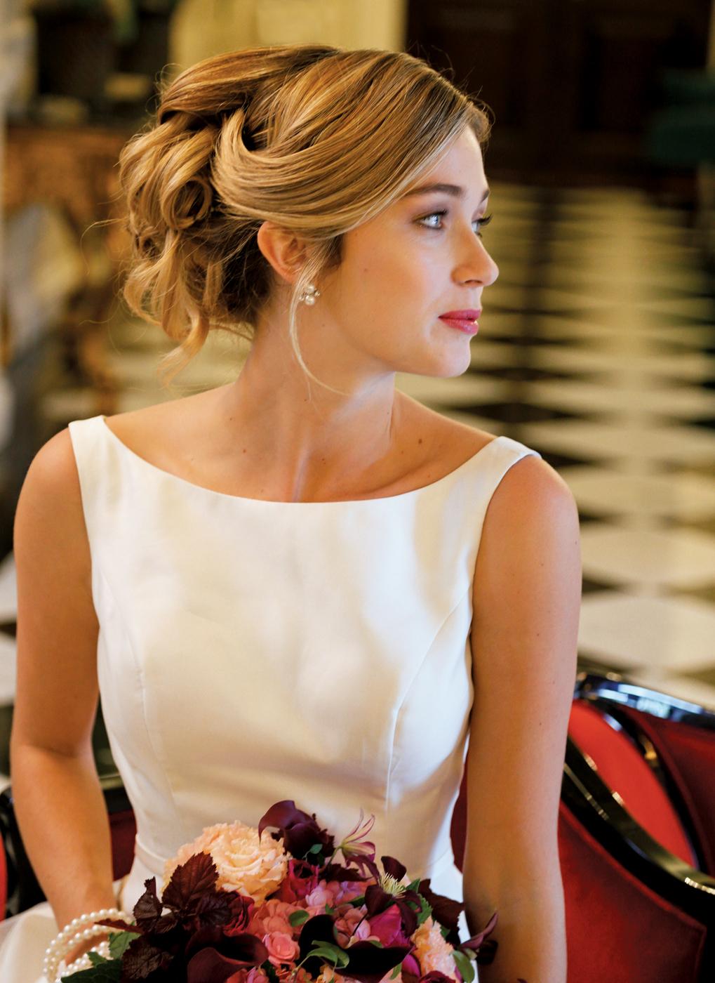 Makeup & Hair: Beauty By Terrie. Gown: Steven Birnbaum (Jo, $3200). Bouquet: PMK Floral Arts.