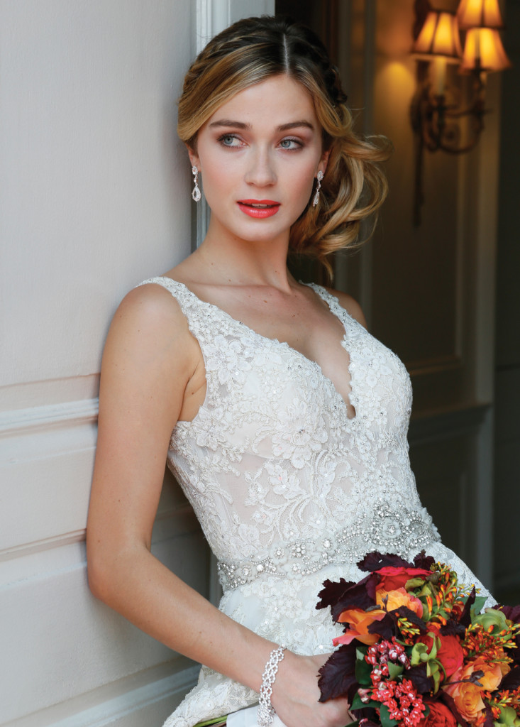 Makeup & Hair: Beauty By Terrie. Gown: Eve of Milady (1561, $4875). Bouquet: PMK Floral Arts.