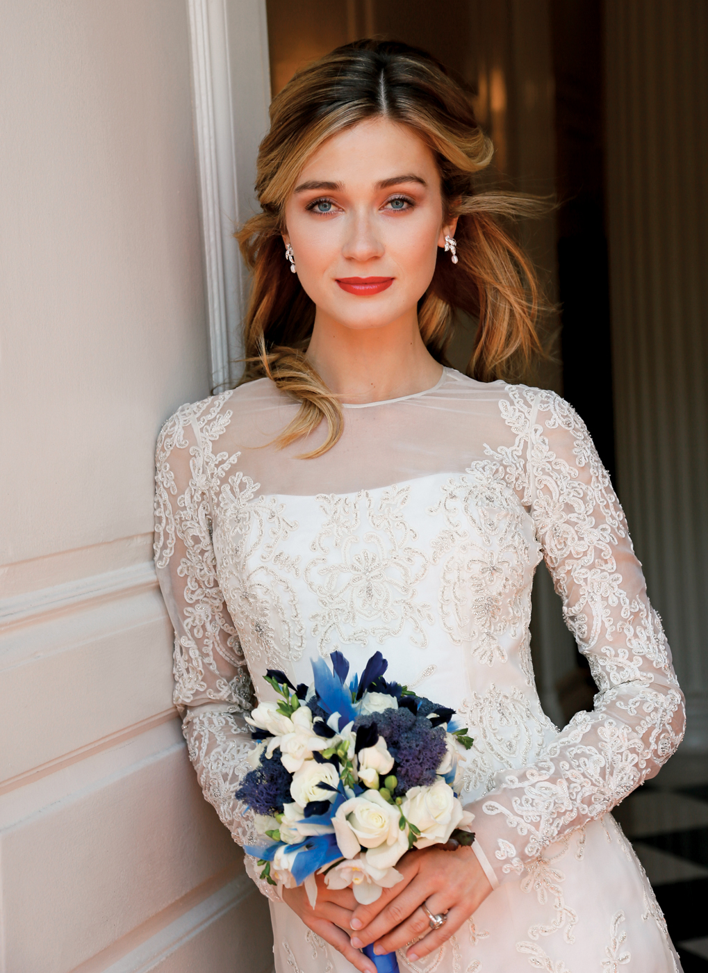 Makeup & Hair: Beauty By Terrie. Gown: Lucia Rodriguez (LW4672, $7400). Bouquet: Sandra's & Donath's.