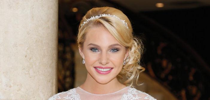 Makeup & Hair: The Bridal Suite NY. Gown: Matthew Christopher at Designer Loft (Carrington, $2900). Bouquet: Ariston Flowers.