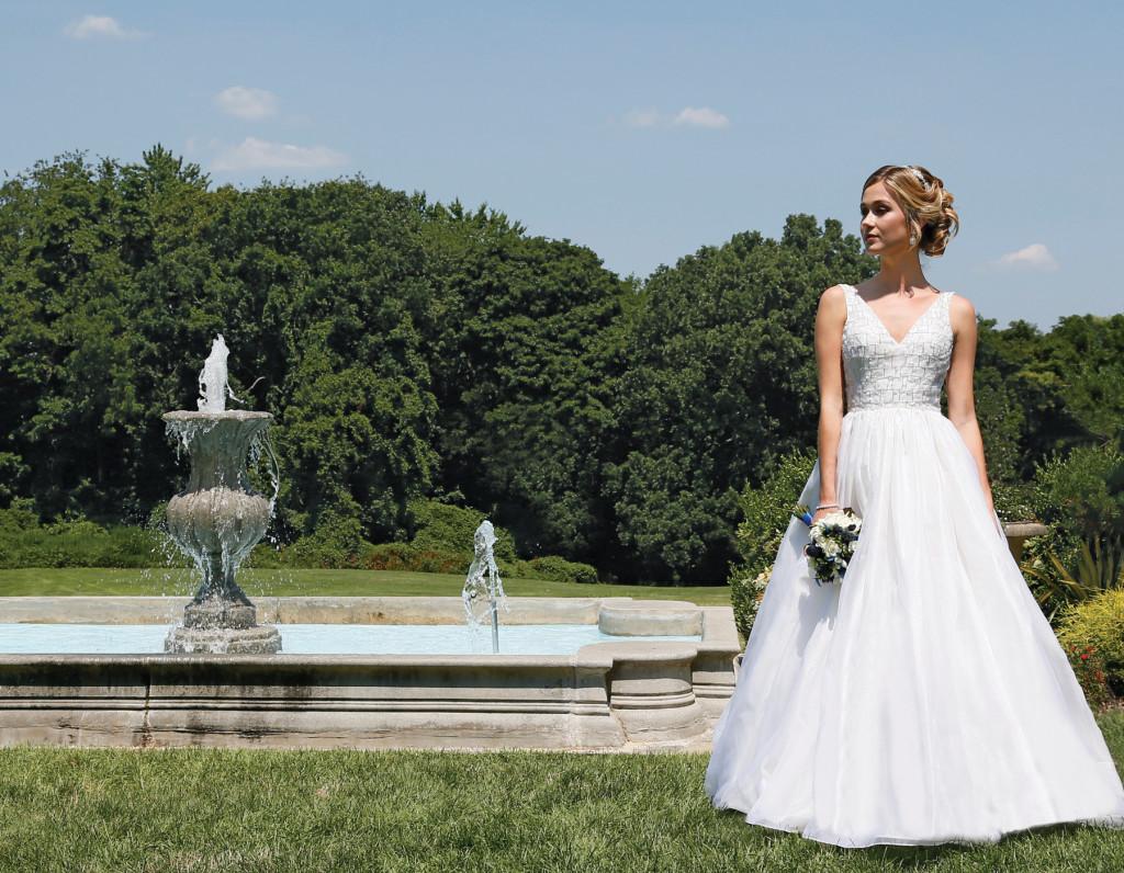 Gown: Steven Birnbaum (Paige, $3350), Sandra's and Donath's Florist