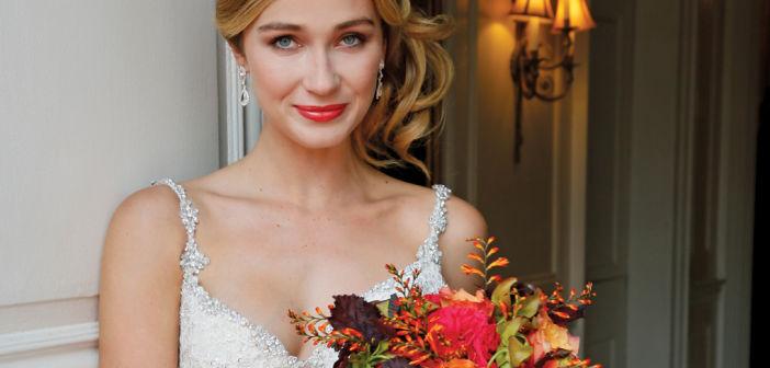 Bouquet: PMK Floral Arts. Gown: Eve of Milady (4349, $6250)