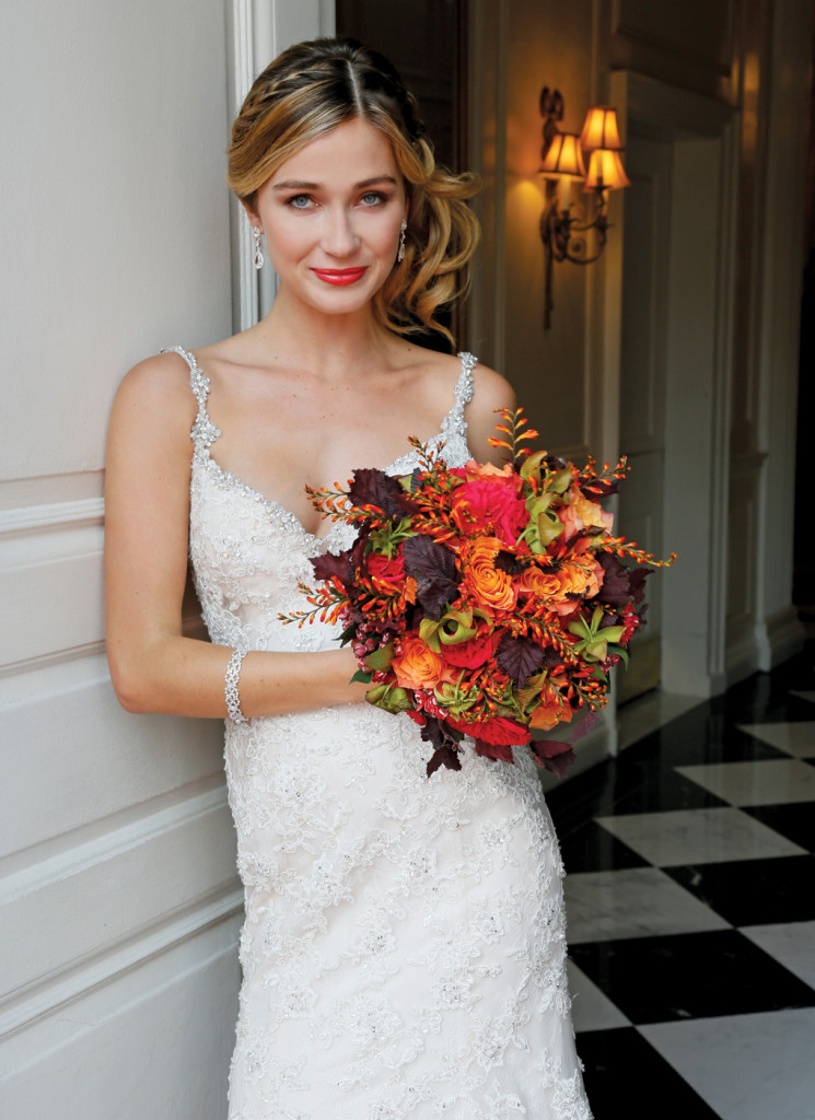 Bouquet: PMK Floral Arts. Gown: Eve of Milady (4349, $6250)