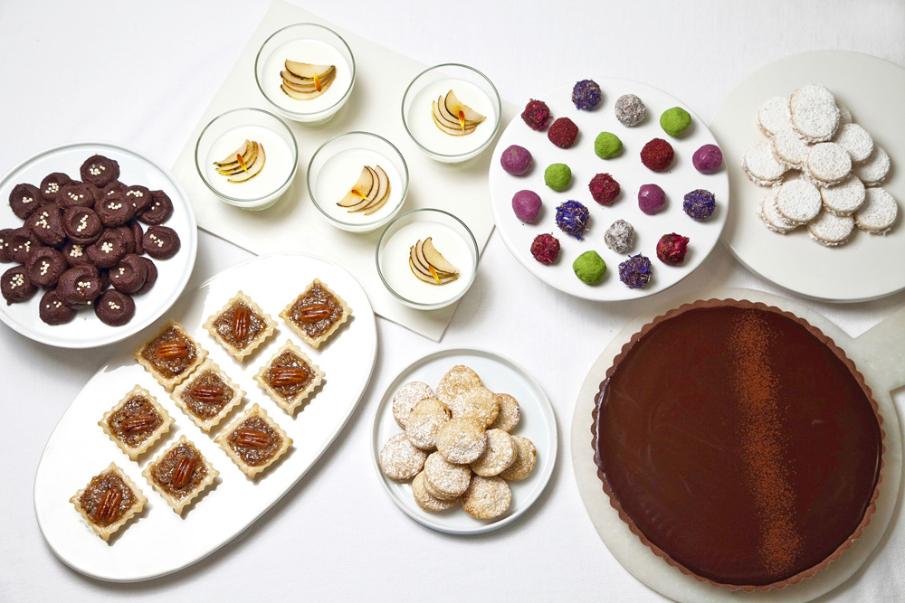 Nuhma New York, Dessert Buffet—Pecan Tartlets, Pear Panna Cotta, Assorted Specialty Truffles, Chocolate Ganache Tart, Alfacores