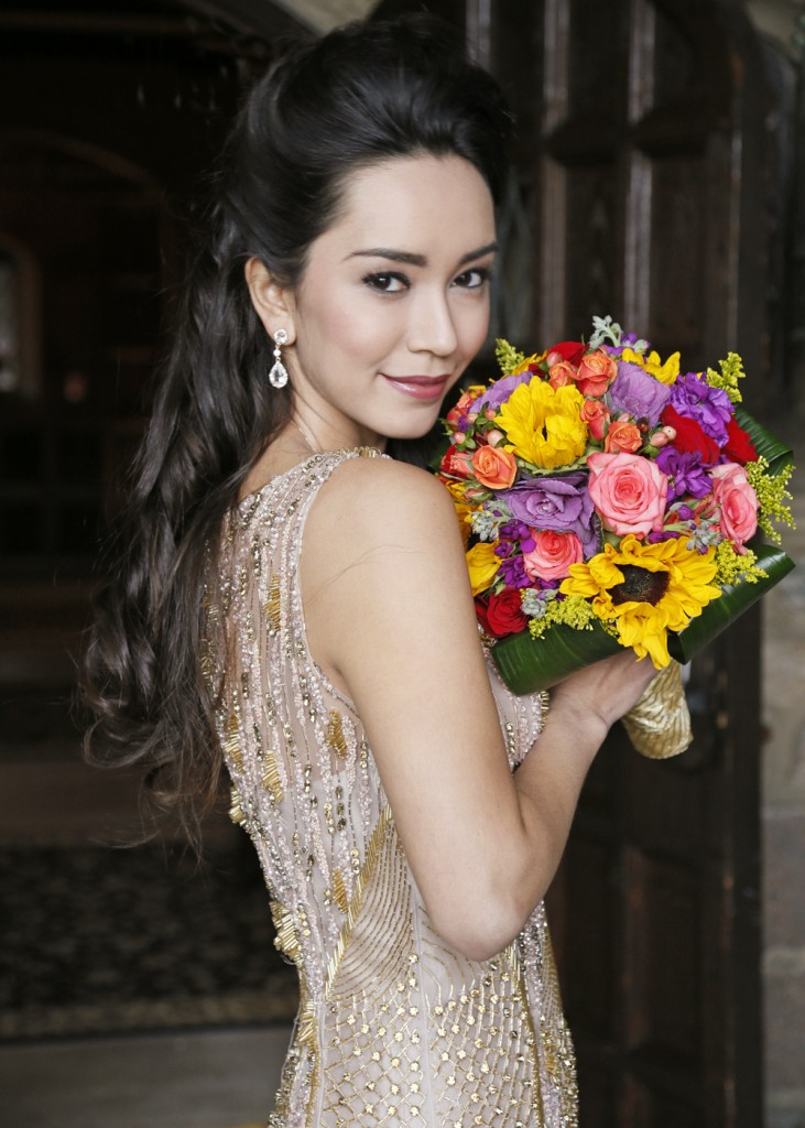 Bouquet: Henry's Florist. Gown: Lucia Rodriguez (LE8400, $14,000)