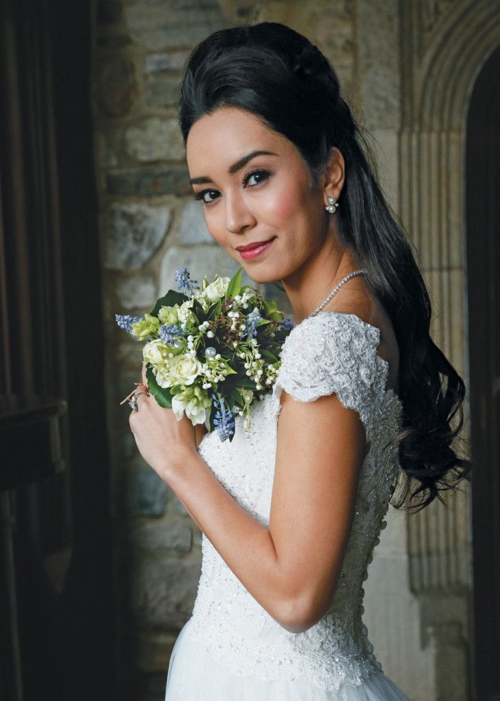 Bouquet: Sandra's and Donath's Florist. Gown: Oleg Cassini (CWG768, $1558)