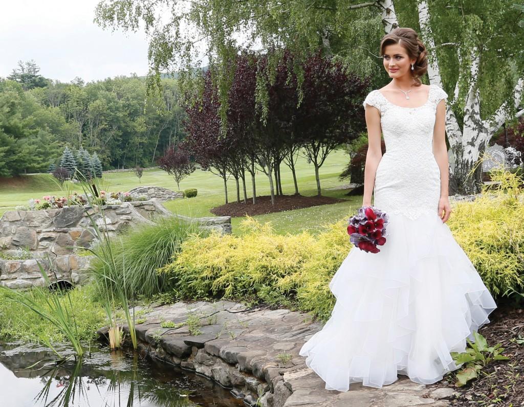 Gown: Oleg Cassini at David's Bridal (CWG750, $1,358), Ariston Flowers