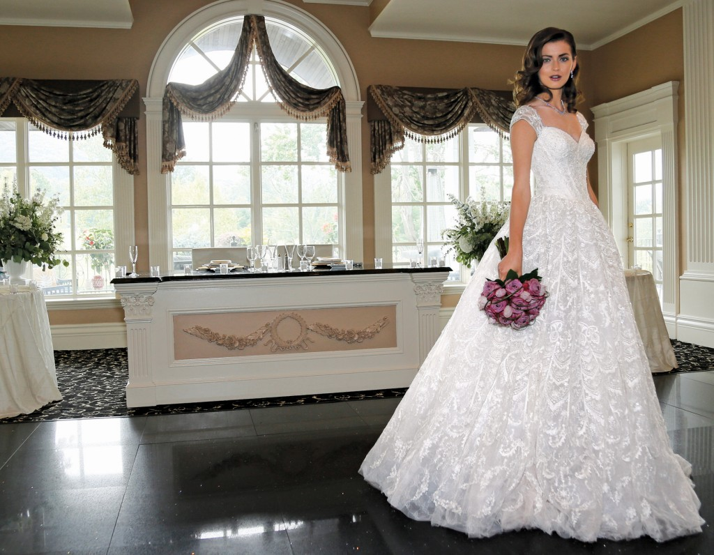 Gown: Oleg Cassini at David's Bridal (CWG766, $1,958), Ariston Flowers