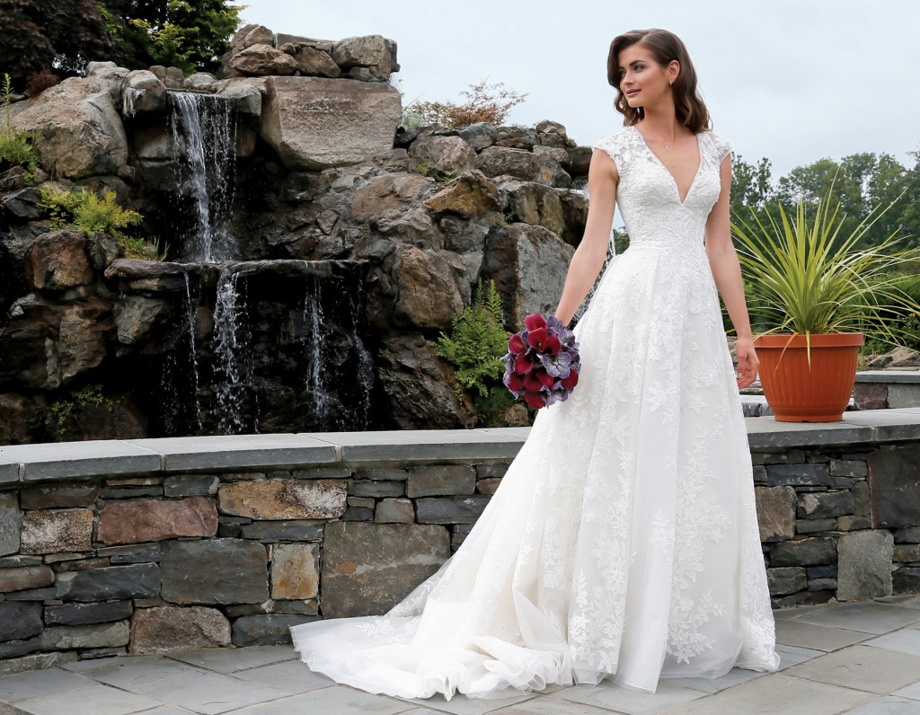 Gown: Oleg Cassini at David's Bridal (CWG748, $1,358), Ariston Flowers