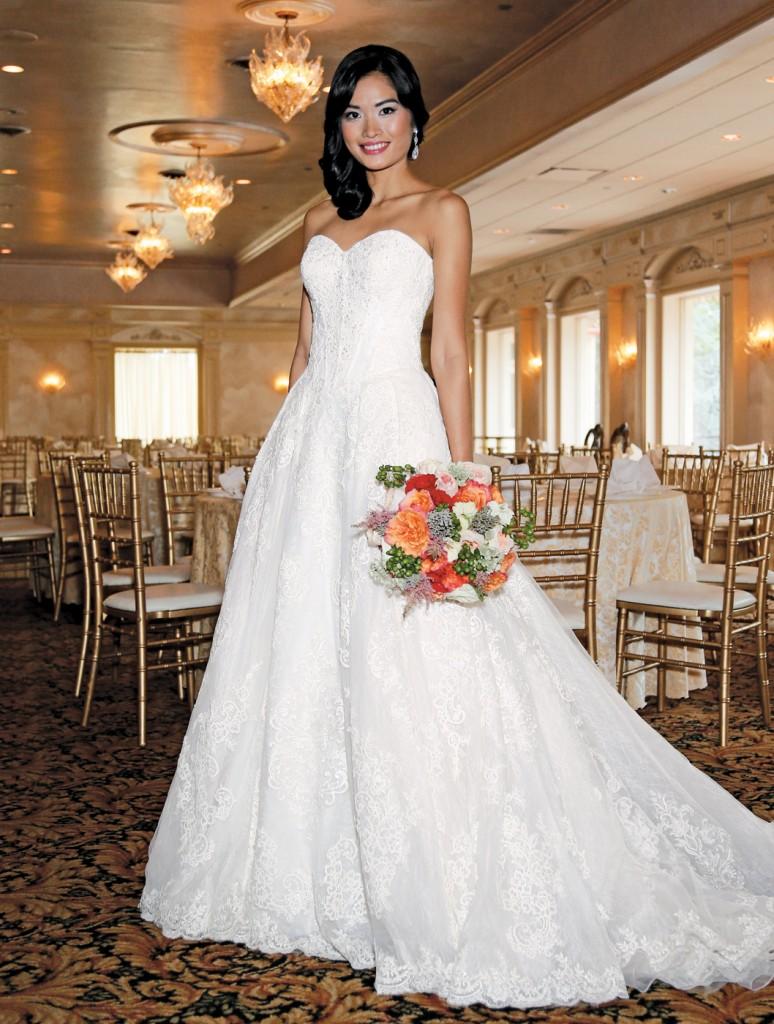 Gown: Oleg Cassini at David's Bridal (CWG749, $1,758), Torcianna Florals