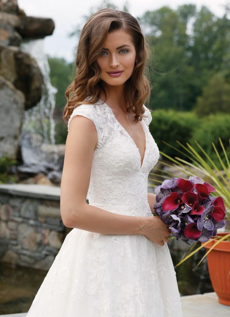 Gown: Oleg Cassini at David's Bridal (CWG748, $1,358), Ariston Flowers