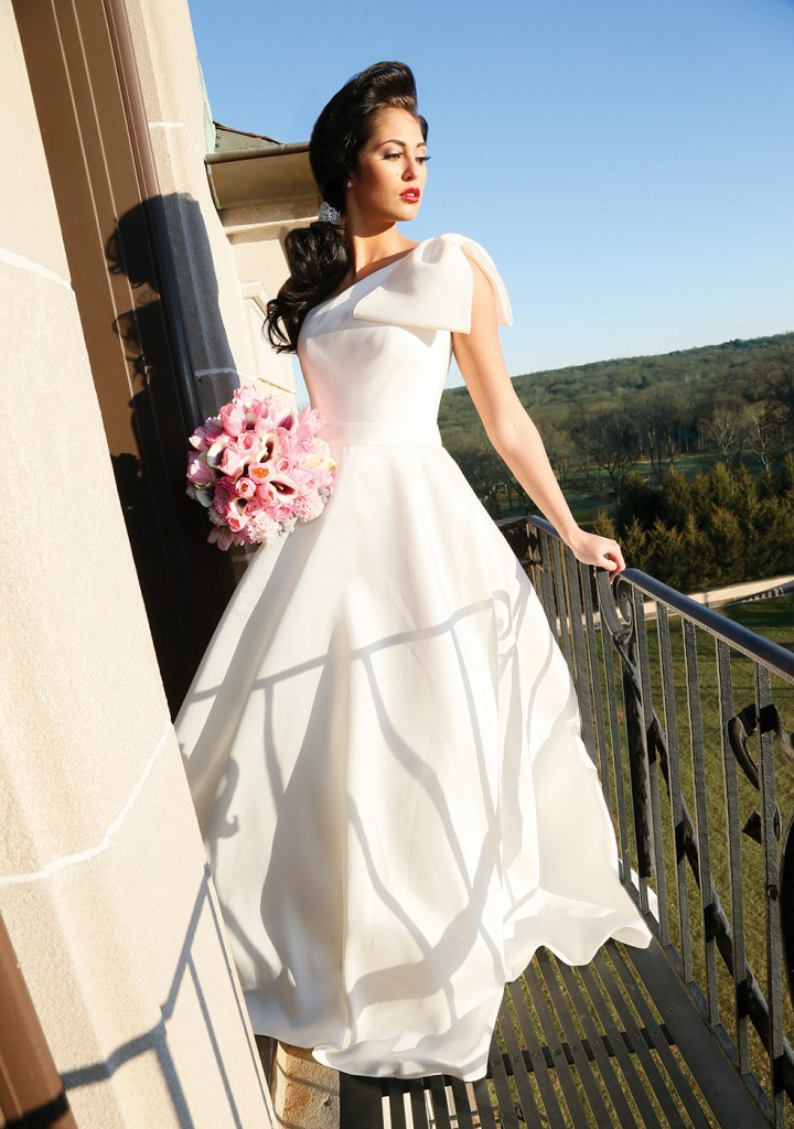 Gown: Oleg Cassini at David's Bridal (CWG793, $658), Ariston Flowers, Earrings-KVO Collections, Bracelet as Hairpiece-David's