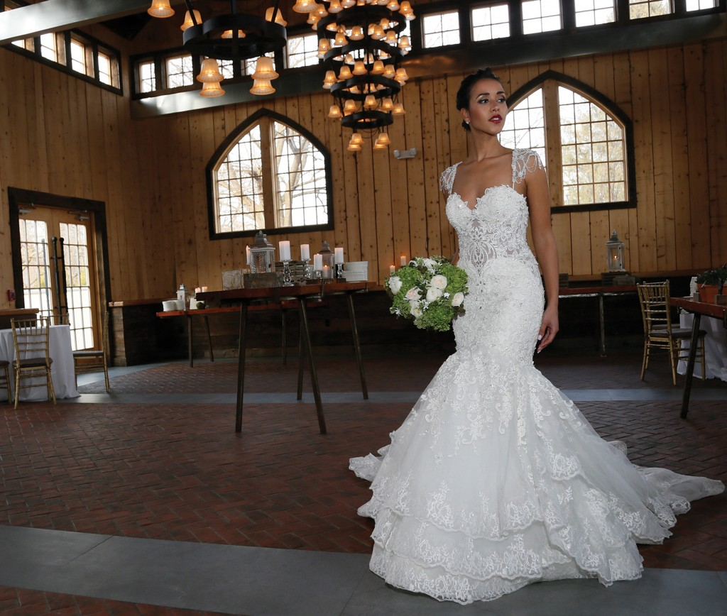 Gown: Eve of Milady (1607), Bouquet: Mitch Kolby Events, Jewelry: KVO Collections