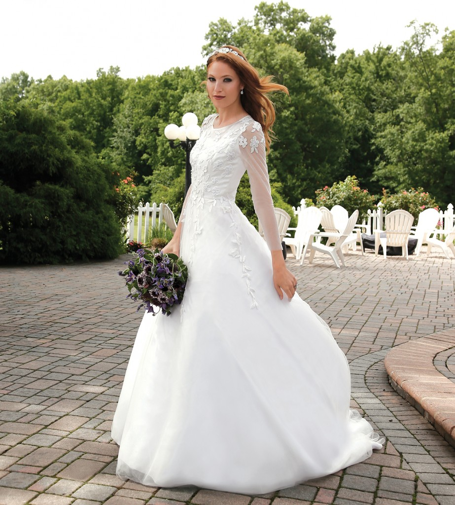 Gown-Lucia Rodriguez (Anny, $7,200), Bouquet-Mitch Kolby Events, Earrings-David's Bridal