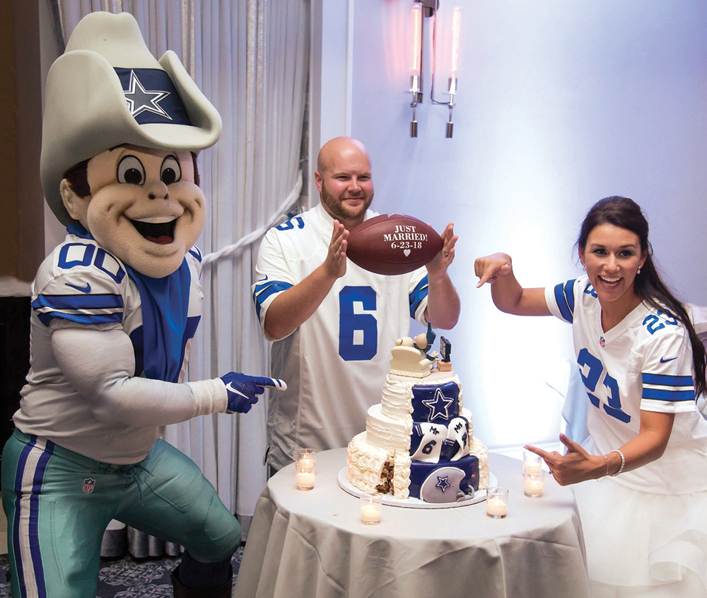 """With Rowdy, the Dallas Cowboys mascot who flew up for their wedding. with the """"Just Married"""" gift football. (Photos: Fantasy Flash)"""