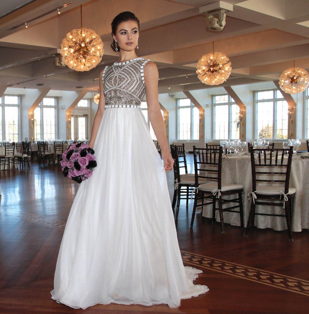 Gown: Lucia Rodriguez (LE8809, $4800). Ariston Flowers