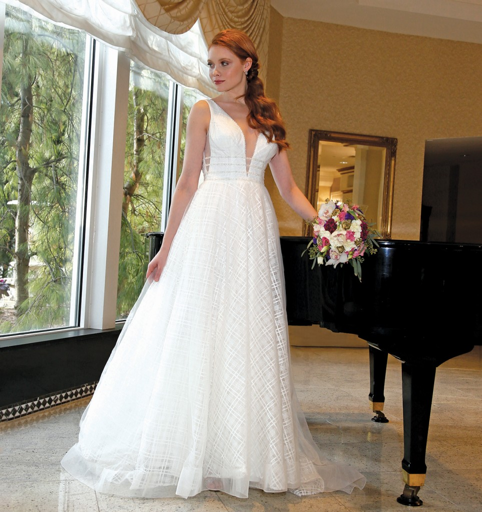 Gown: Galina Signature at David's Bridal (SV817, $1158). Henry's Florist