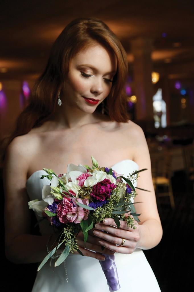 Gown: Jude Jowilson (Leslie). Henry's Florist