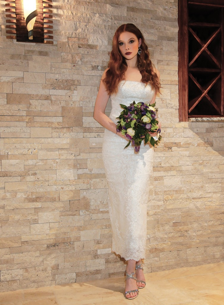 Gown: Oleg Cassini at David's Bridal (CWG812, $1458). Bouquet: Mitch Kolby Events