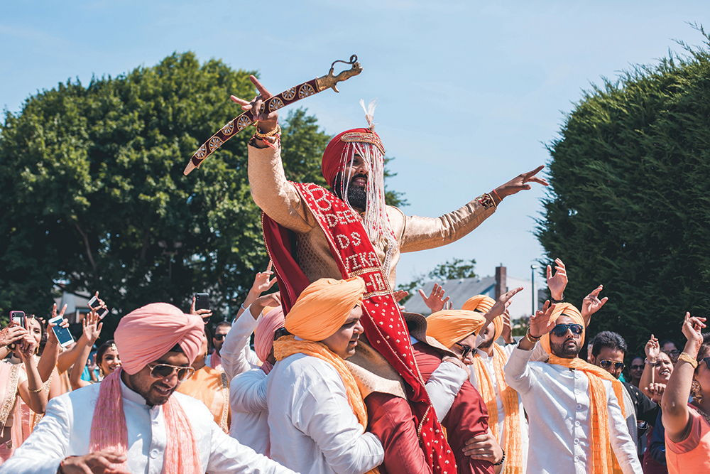 The Baraat: The Groom's procession, as his entire family and friends lead him to the altar. (Christopher Brock Photography)