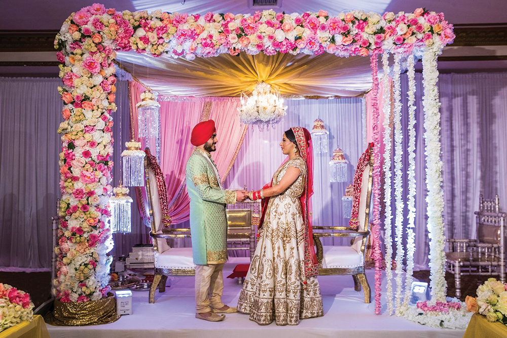 Bride & Groom in front of the mandap (Jay Seth Photography)