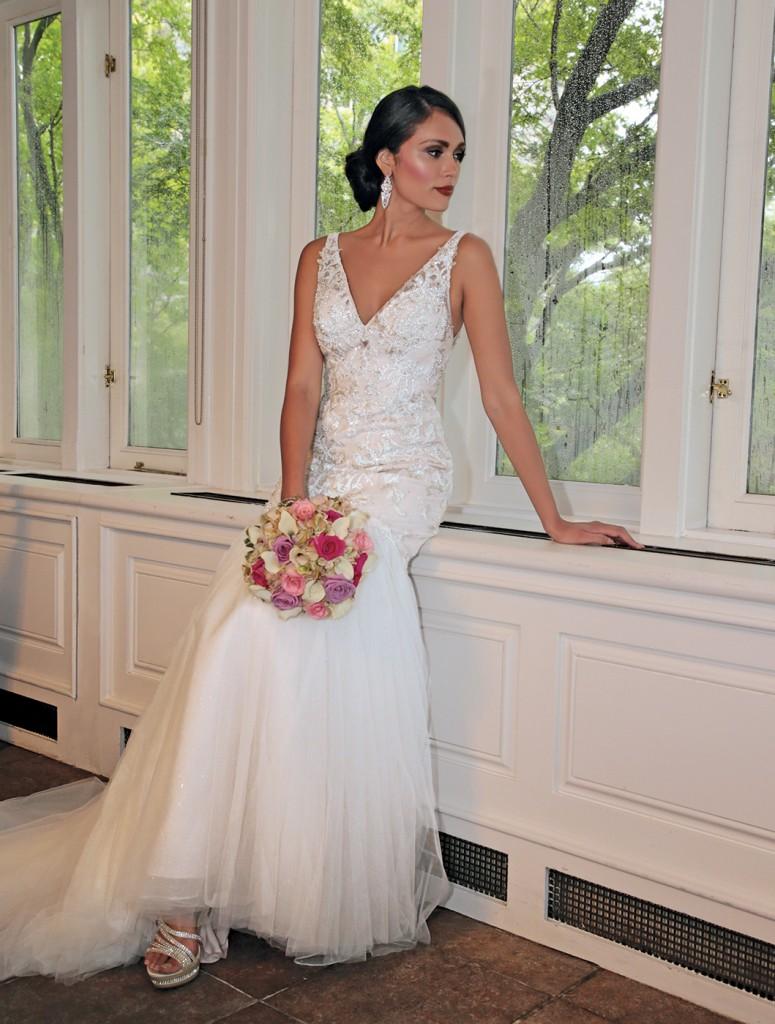 Gown: Oleg Cassini (CWG832, $1158) at David's Bridal. Bouquet: Henry's Florist Floral Decorators.