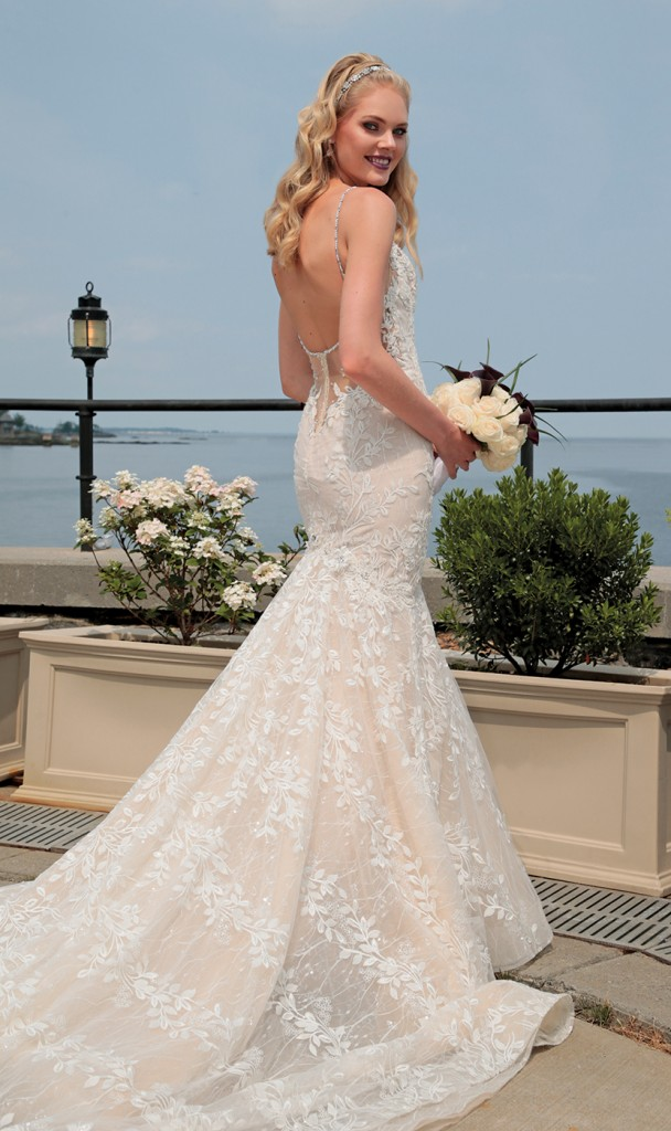 Gown: Eve of Milady (4375). Bouquet: Ariston Flowers.