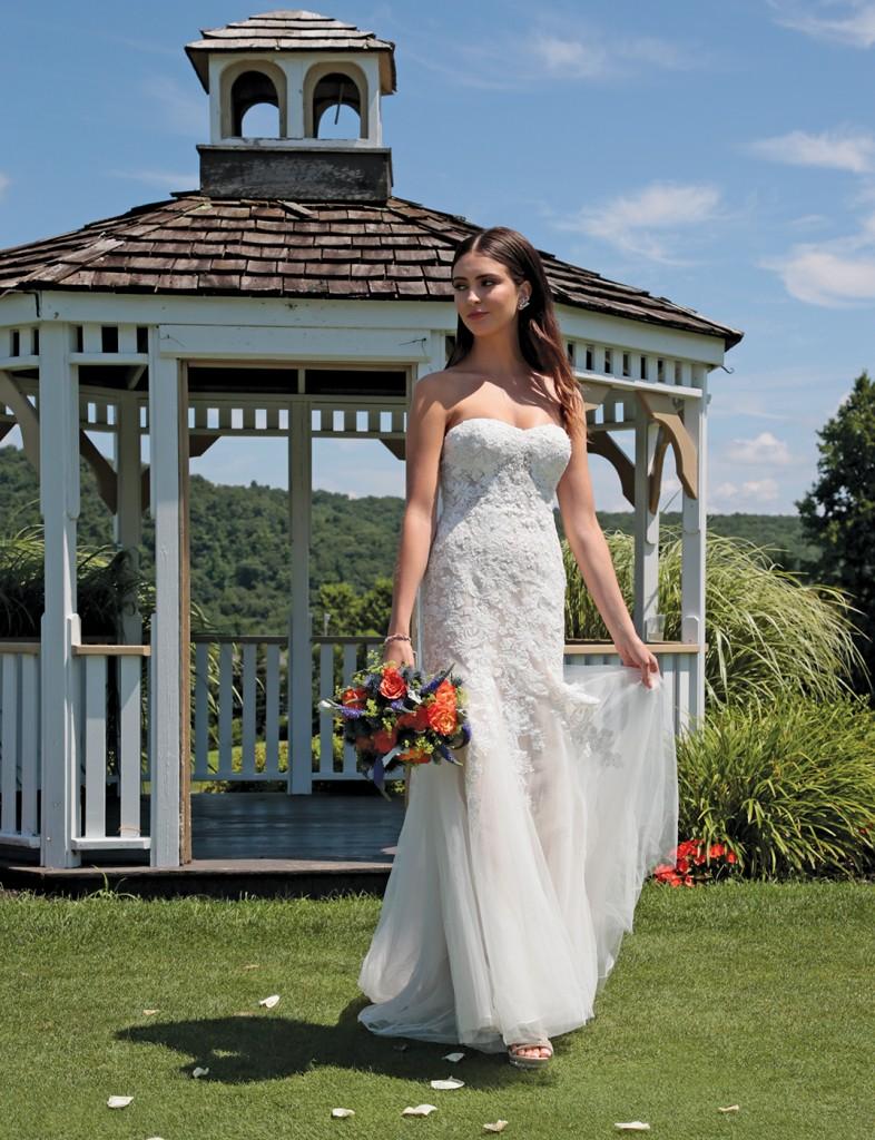 Gown: David's Bridal (WG3964, $899). Bouquet: Douglas Koch Designs Ltd.