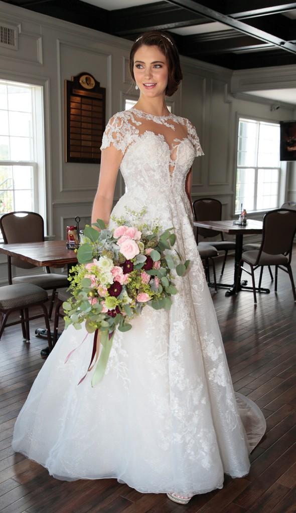 Gown: Oleg Cassini (CWG833, $1658) at David's Bridal. Bouquet: Douglas Koch Designs Ltd.