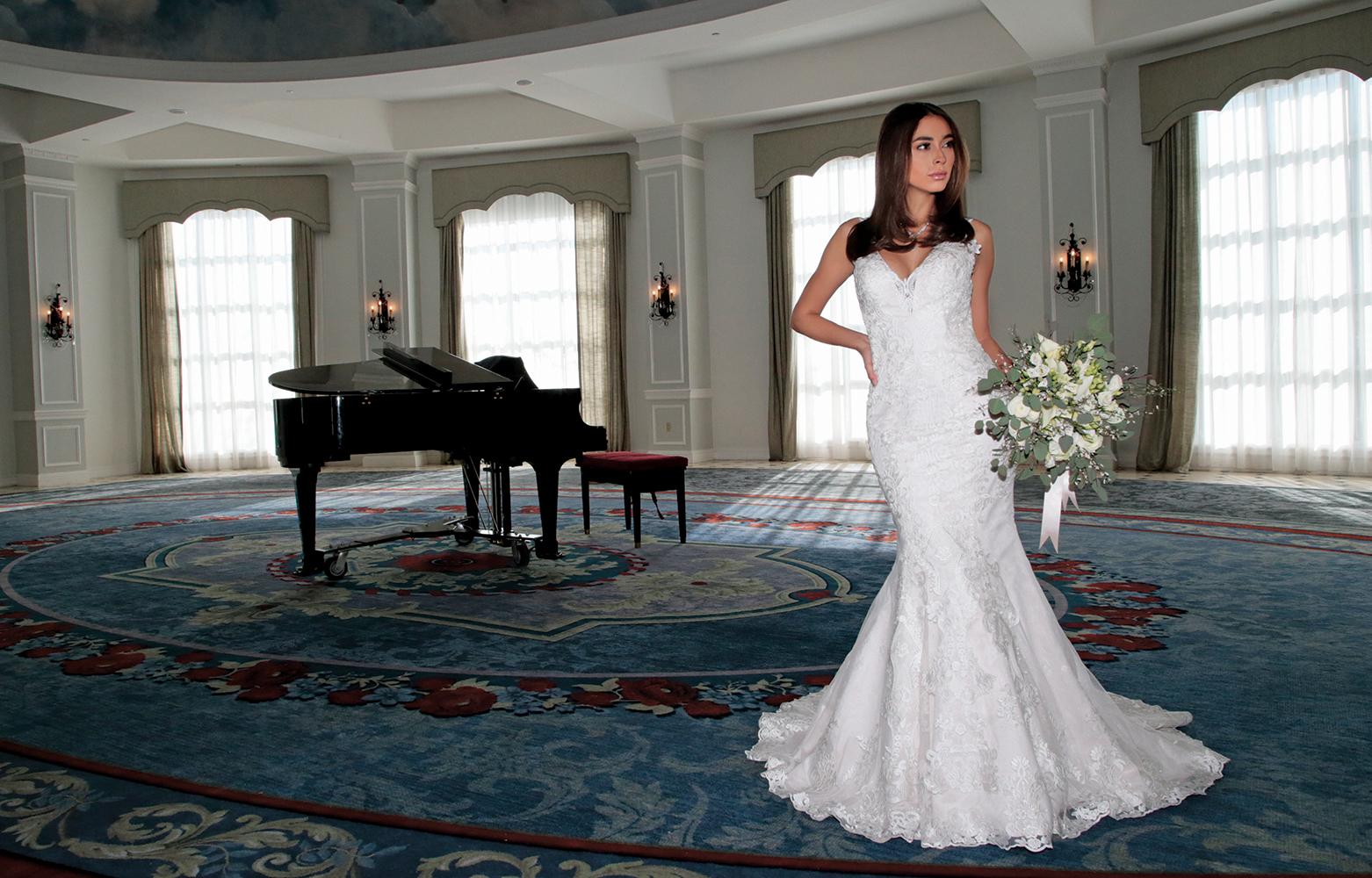 Gown: Bossina Couture (BC621, $1800). Bouquet: Douglas Koch Designs Ltd.