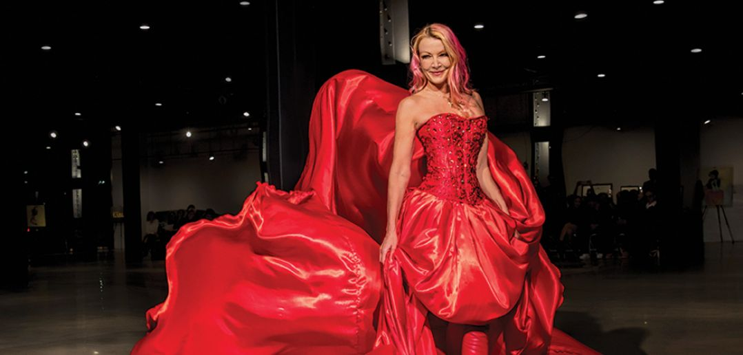 Malena, dramatically opening her newest Journey Fashion Festival. Gown: Richard Petit of Papillon Dezign. Photo: Dennis Madigan