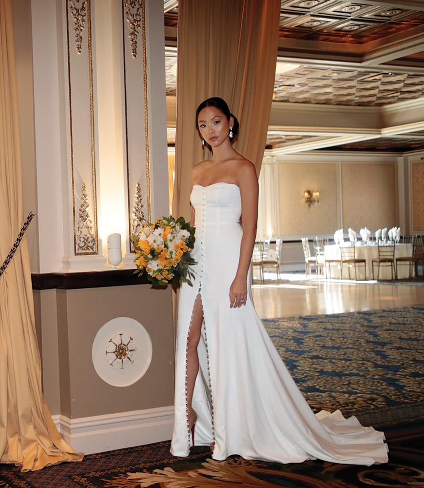 Gown: David's Bridal (WG3992, $399) at David's Bridal. Bouquet: Henry's Florist Floral Decorators.