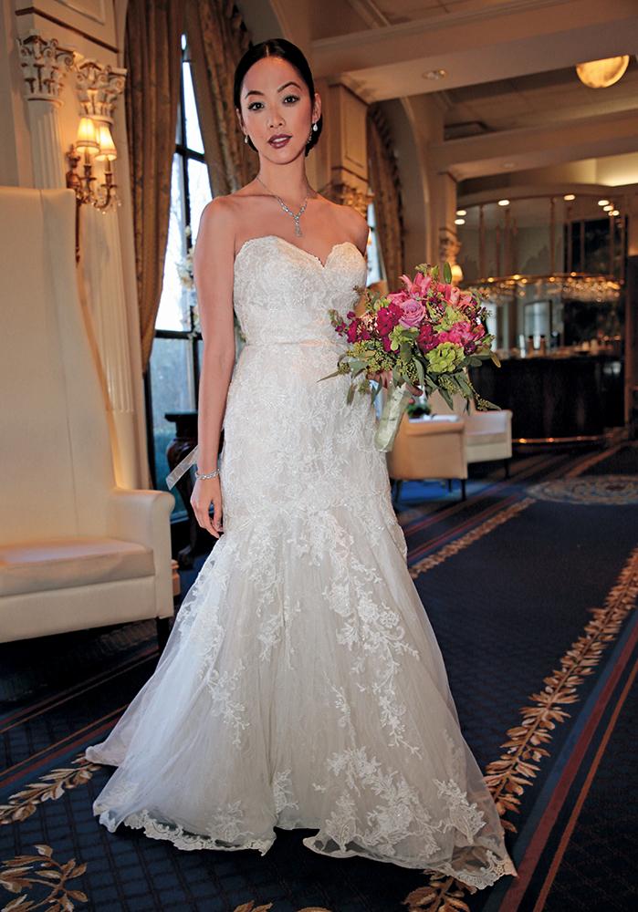 Gown: David's Bridal (WG3988, $899) at David's Bridal. Bouquet: Henry's Florist Floral Decorators.