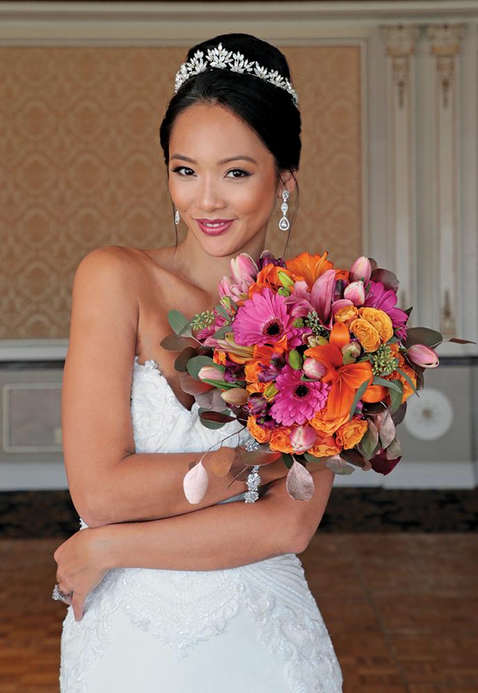 Gown: Jude Jowilson (Astor). Bouquet: Henry's Florist Floral Decorators.